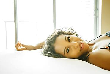 Close up of woman laying on hotel bed