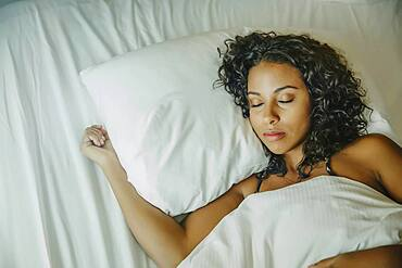 Close up of woman sleeping in bed