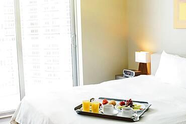 Breakfast tray on hotel bed