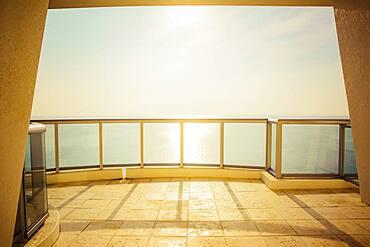 Balcony overlooking ocean and sunny sky