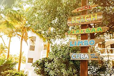Tourist signs for beach and pool