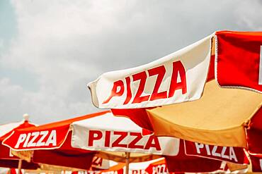 Low angle view of pizza on umbrellas outdoors