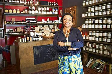 Black woman smiling in tea shop
