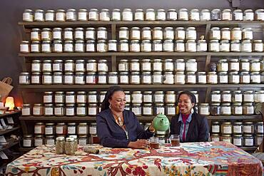 Black women drinking tea in tea shop