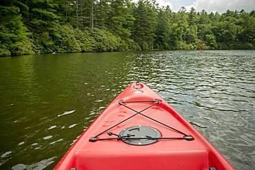 Canoe floating on remote lake