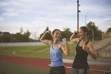 Athletes flexing their muscles on sports field