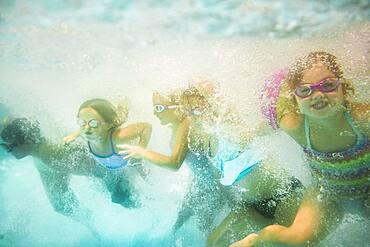 Children underwater in swimming pool