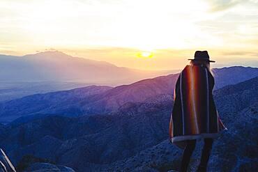 Caucasian woman overlooking remote desert landscape