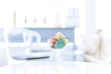 Variety of macaroon cookies in glass
