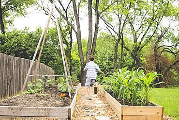 Caucasian boy running in backyard