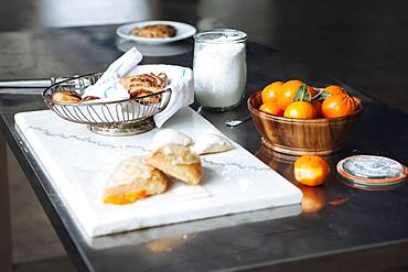Bread, cheese and fruit on table