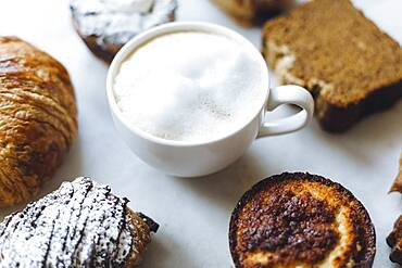 Close up of variety of pastries and coffee