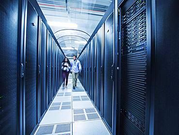 Technicians walking in server room