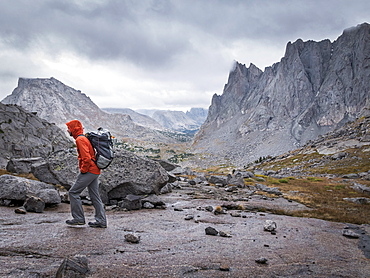 Caucasian hiker walking near mountains