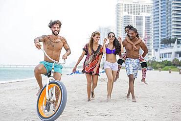 Friends walking on urban beach