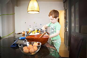 Boy cooking in kitchen