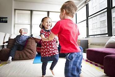 Children dancing in living room