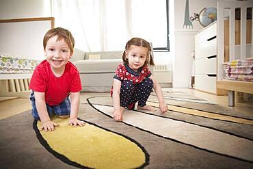 Children playing on floor in bedroom