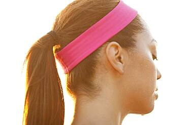 Rear view of sweating Hispanic woman