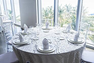 Set table at window in restaurant