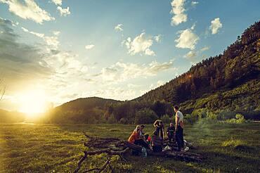 Caucasian friends in rural field