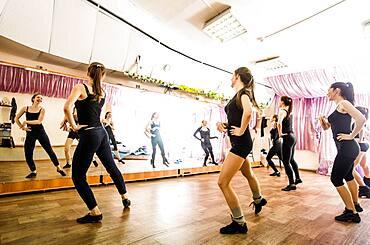 Caucasian dancers practicing in studio