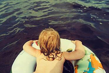 Caucasian girl swimming in lake