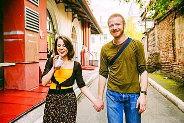 Caucasian couple walking in city street