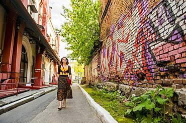 Caucasian woman walking in city street