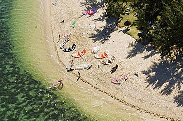 Aerial view of kitesurfers on beach