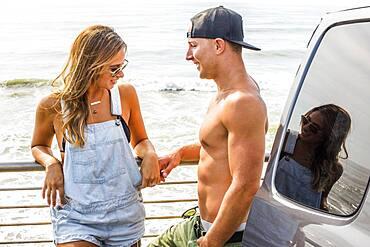 Caucasian couple talking outdoors at beach