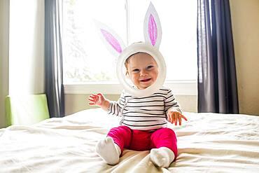 Caucasian baby girl wearing Easter Bunny costume