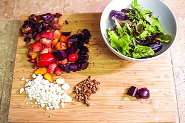 Chopped fruit, nuts and cheese with salad bowl