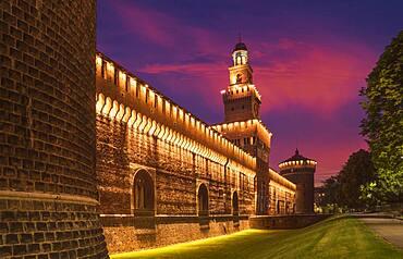 Illuminated tower and castle walls, Milano, Lombardia, Italy