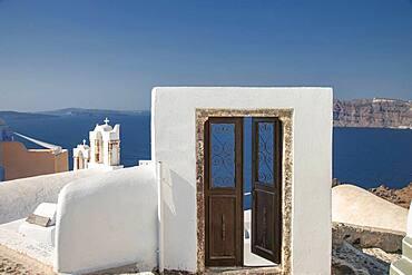 Door on hilltop over seascape