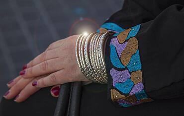 Caucasian woman wearing gold bracelets