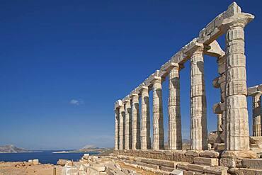Temple of Poseidon ruins under blue sky, Cap Sunion, Greece