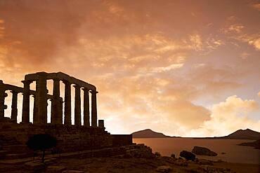 Temple of Poseidon under sunset sky, Cap Sunion, Greece