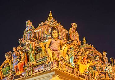 Low angle view of statues on ornate temple dome
