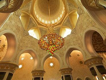 Low angle view of chandelier in ornate dome, Abu Dhabi, Abu Dhabi Emirate, United Arab Emirates