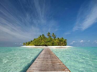 Wooden dock walkway to tropical island