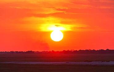 Glowing sunset over remote landscape