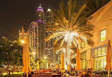 Illuminated high rise buildings in Dubai cityscape, Dubai Emirate, United Arab Emirates