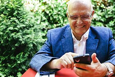 Hispanic businessman using cell phone