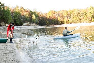Couple kayaking in remote lake