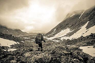 Mari backpacker walking in mountain valley