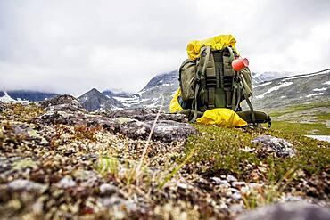 Backpack in mountain field