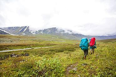 Backpackers walking on rural path
