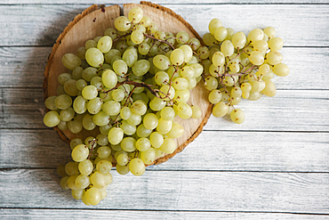 Green grapes on cutting board