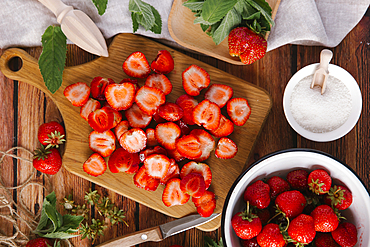 Close up of sliced strawberries on cutting board
